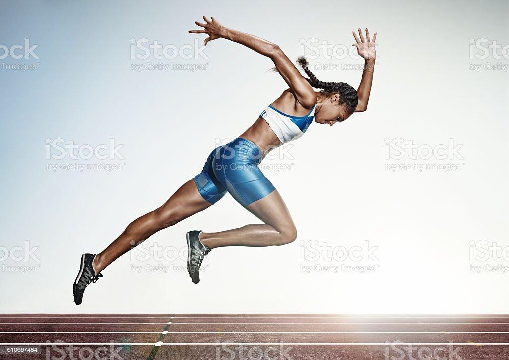 The female athlete running on runing track stock photo