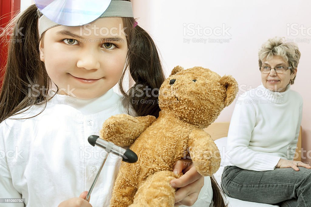 The female doctor examining little children royalty-free stock photo