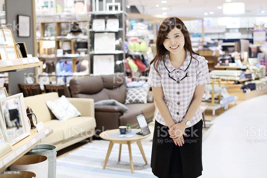 The female employee who bows stock photo