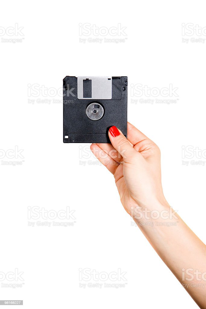 The female hand holds a diskette royalty-free stock photo