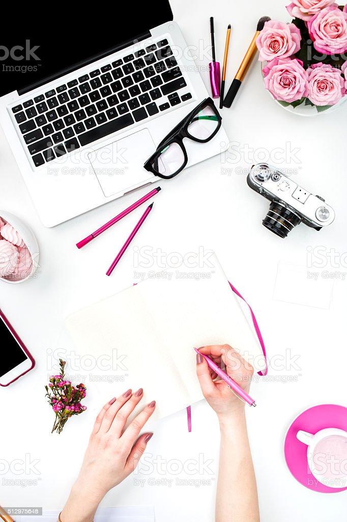 The female hands writing against fashion woman objects stock photo