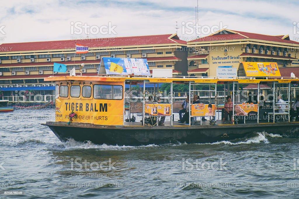 The ferry is sailing to Wat Rakhang Pier, Bangkok, Thailand. stock photo
