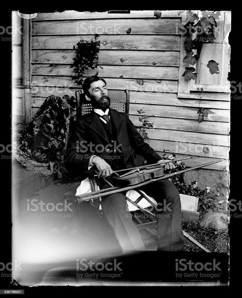The Fiddler, Circa 1890 stock photo