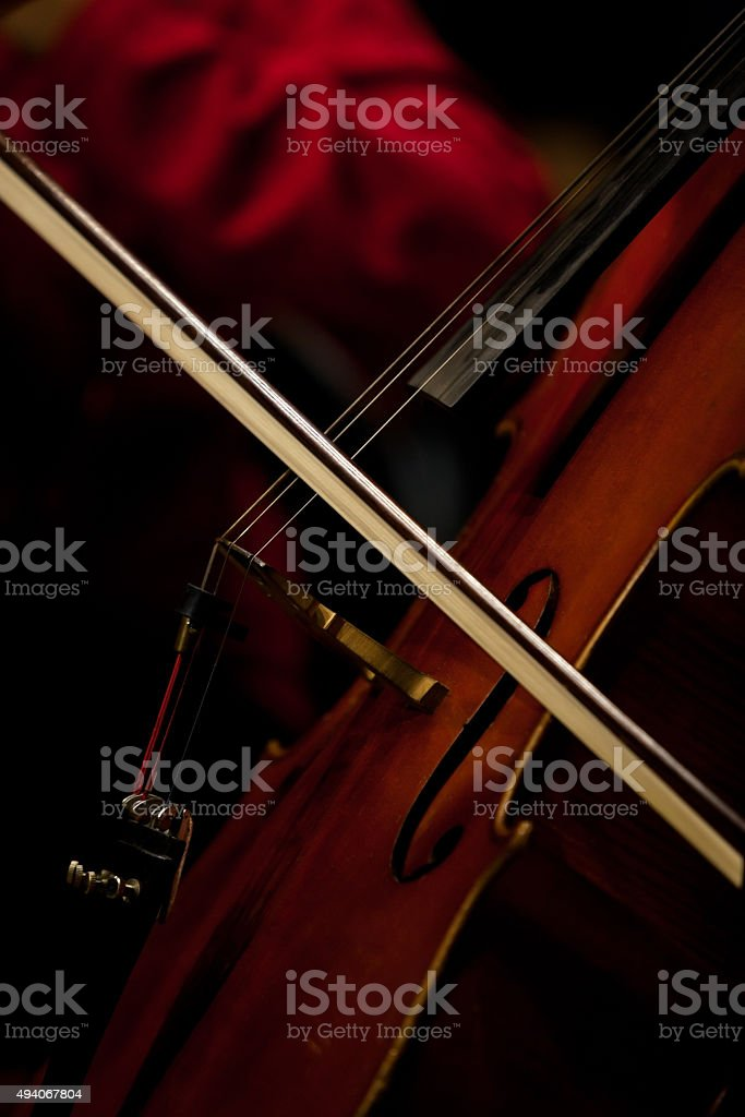 The fiddlestick  on the strings cello stock photo
