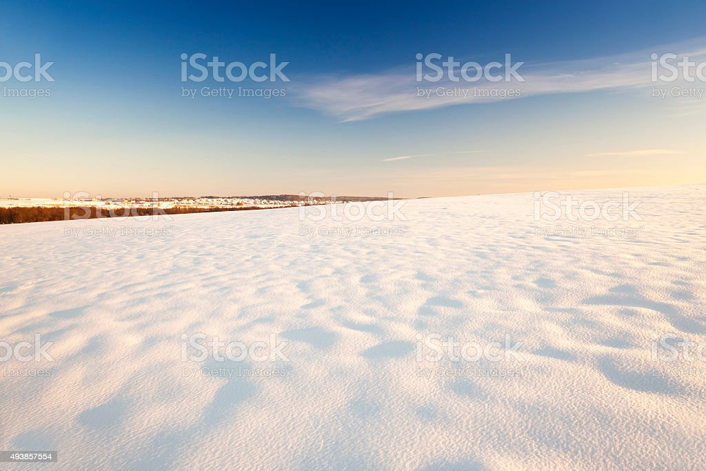 the field covered with snow stock photo