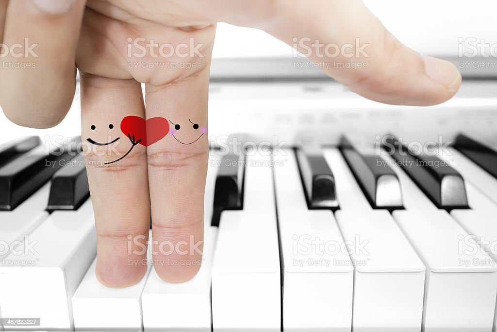 The finger lover send red heart on piano stock photo