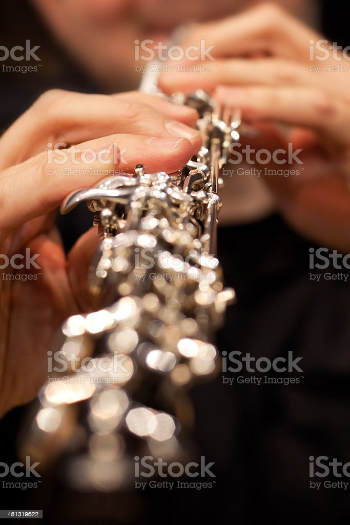 The fingers of the person playing the oboe stock photo