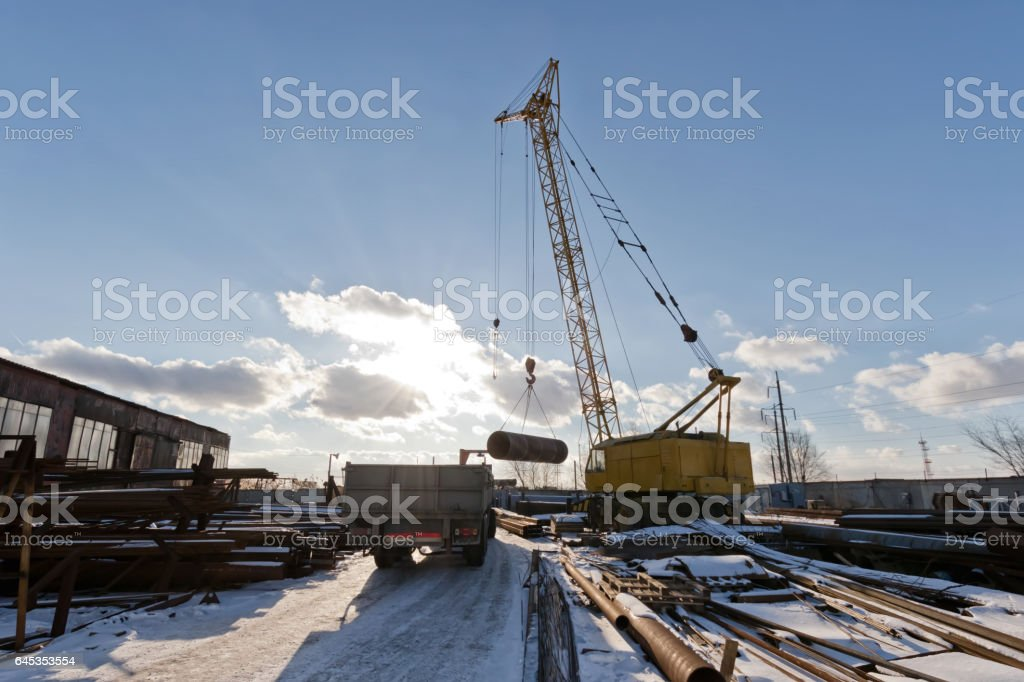 The finished shell of the heat exchanger unload the crane stock photo
