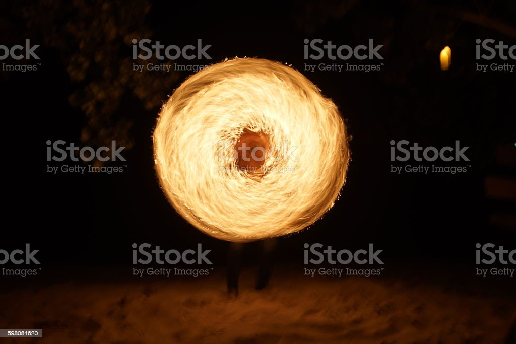The fire dancing stock photo