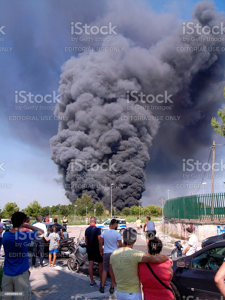 The fire in a parking lot of cars. stock photo