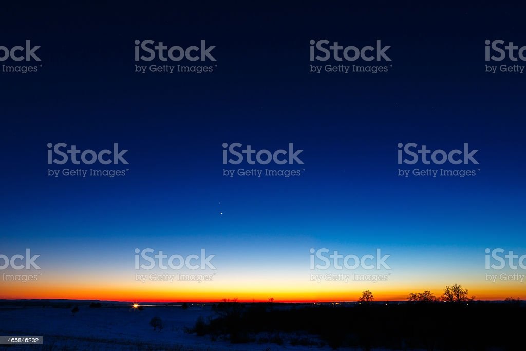 The first stars in the background of a bright sunset. stock photo