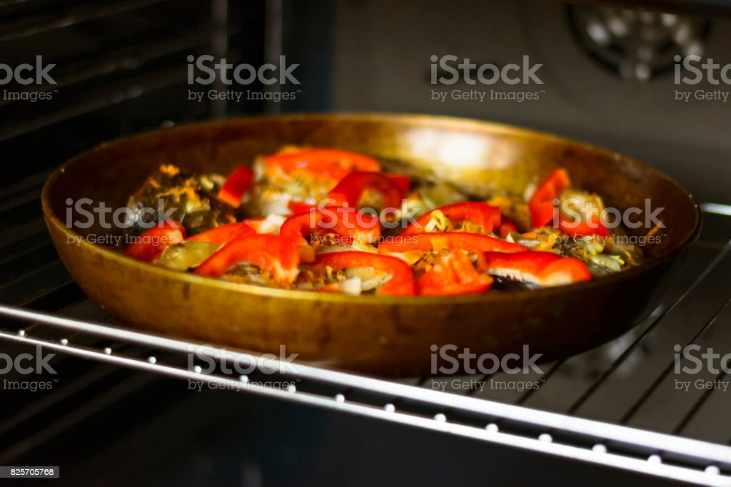 The fish in the pan with the red pepper and spices stock photo