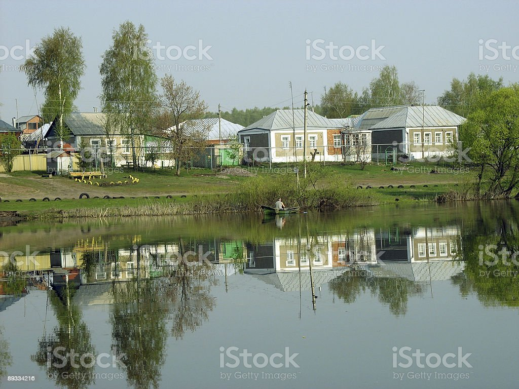 The fisherman floats by a boat. royalty-free stock photo