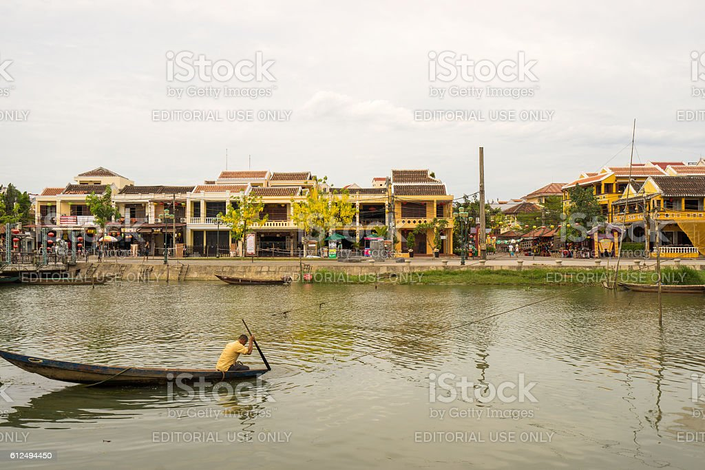 The fisherman on the boat on the Thu Bon river stock photo