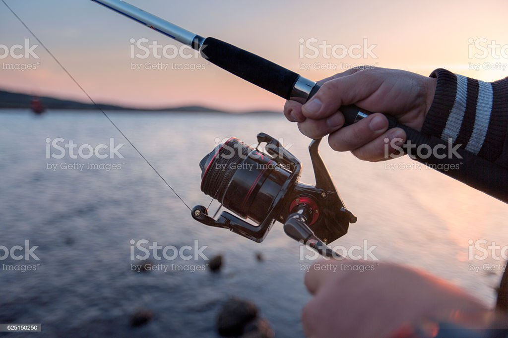 The fishermen are catching the seaside stock photo