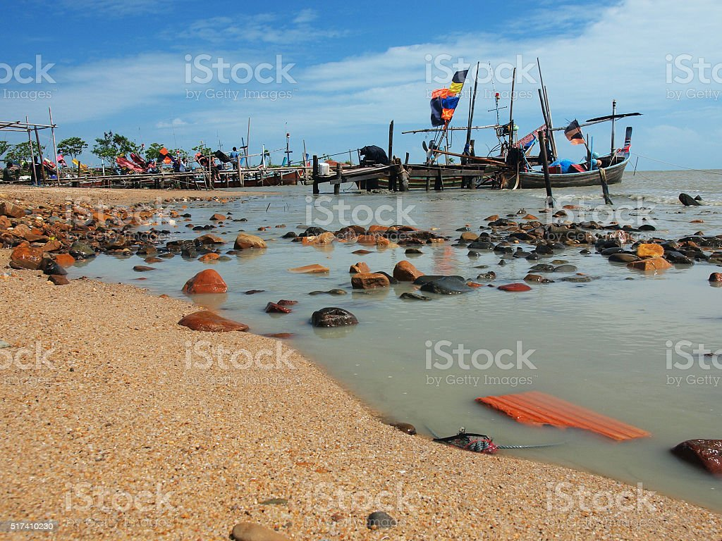 The fishing boats at the coast in southern Thailand stock photo