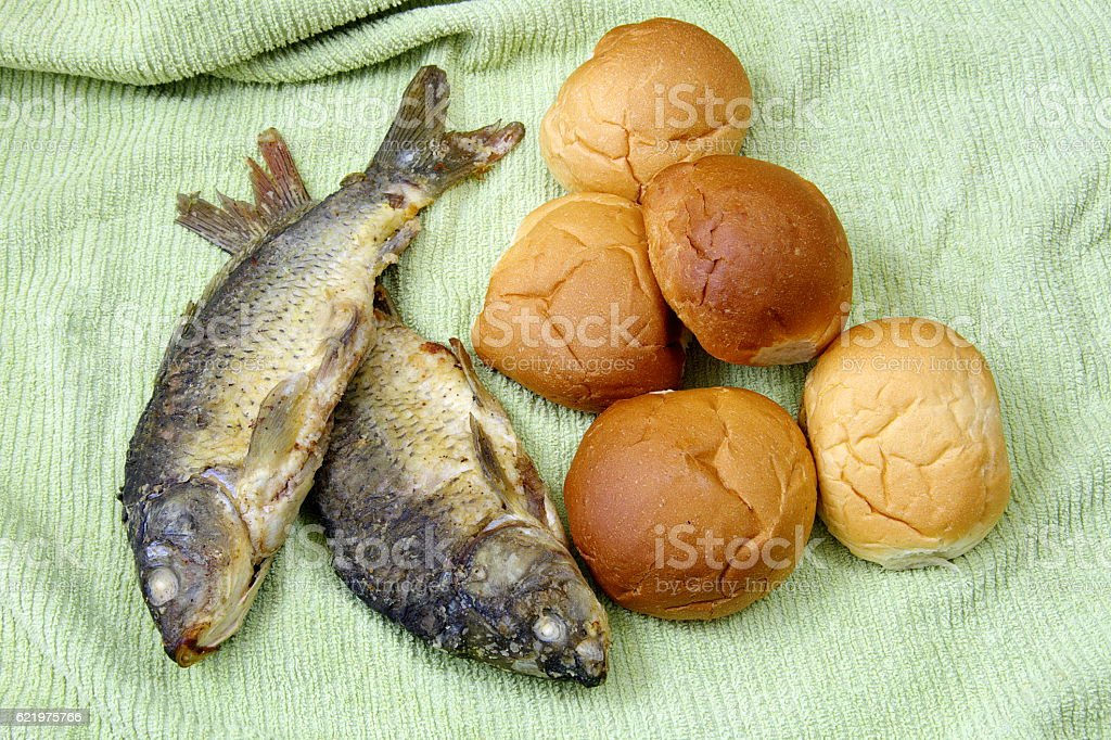 The five loaves, and the two fishes. stock photo