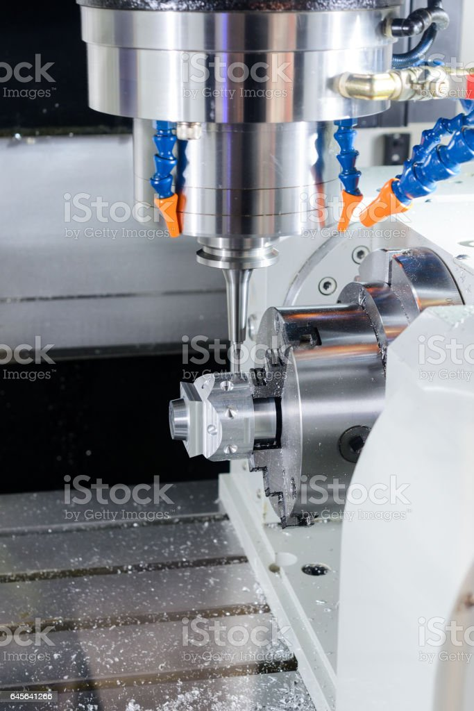 The five-axis CNC machine while cutting sample part stock photo