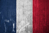 The Flag of France on grunge wall background