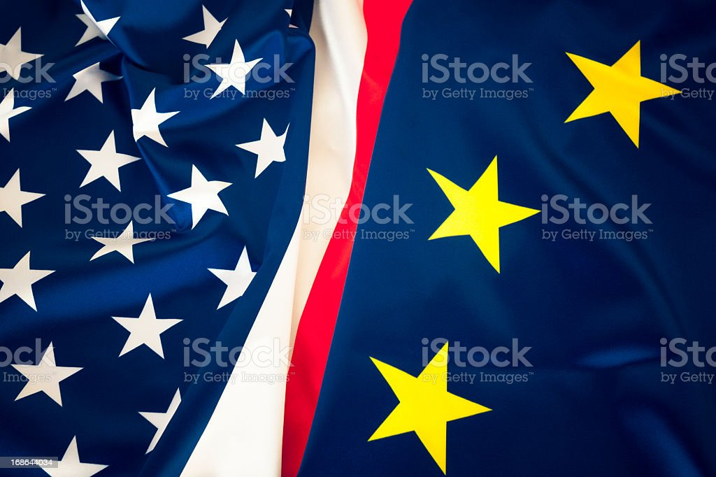 The flags of us-eu combined in a symbolic gesture of unity royalty-free stock photo