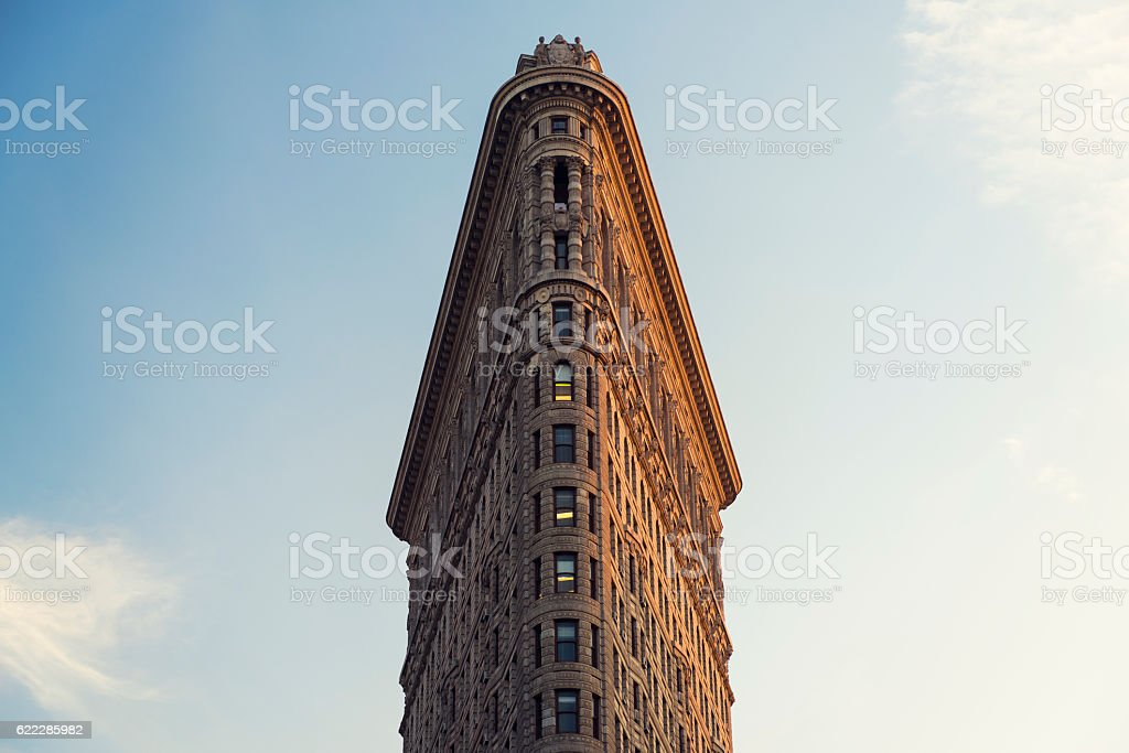 The Flatiron Building in New York City at Sunset stock photo