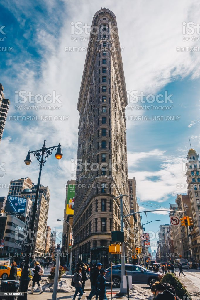 The Flatiron Building, originally the Fuller Building, is a triangular 22-story steel-framed landmarked building located at 175 Fifth Avenue in the borough of Manhattan, is considered to be a groundbreaking skyscraper. stock photo