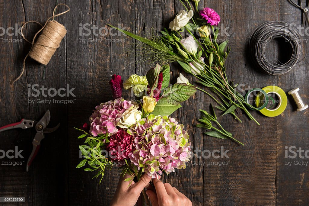 The florist desktop with working tools and ribbons stock photo