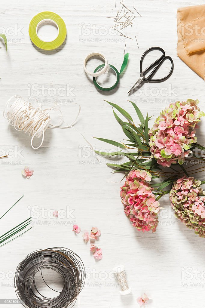 The florist desktop with working tools stock photo