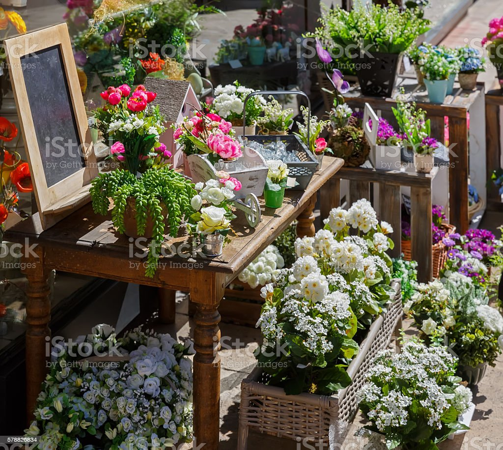 The flowers are sold from a tray on the street stock photo