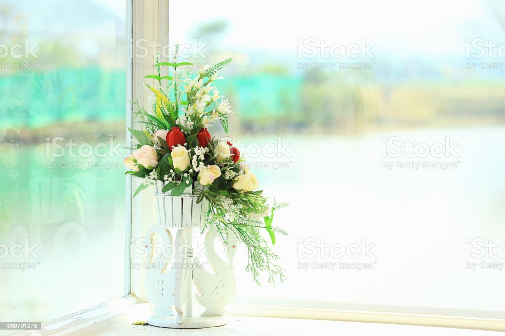 The Flowers in the vase and near the windows. stock photo