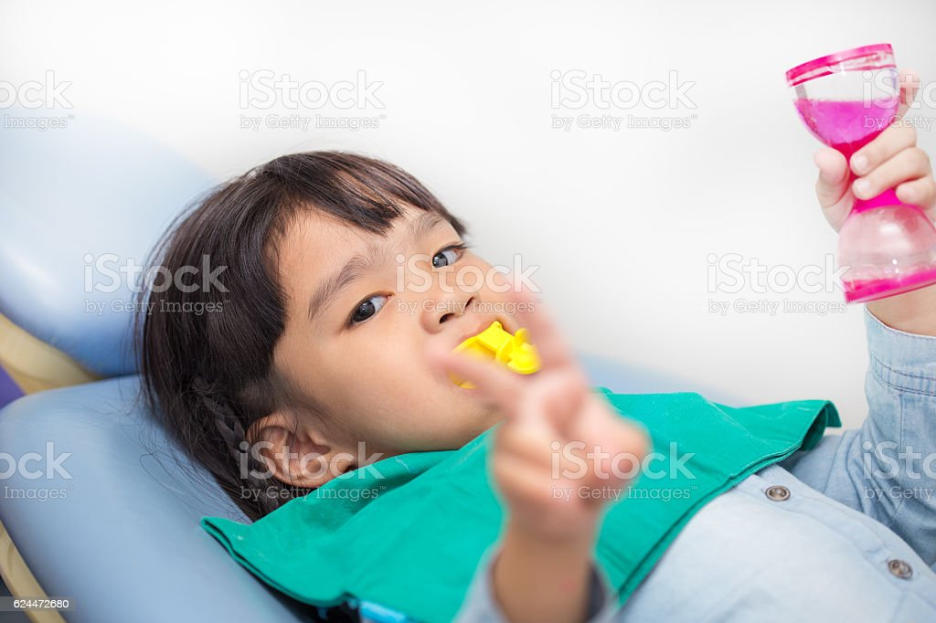The Fluoride coating in children stock photo