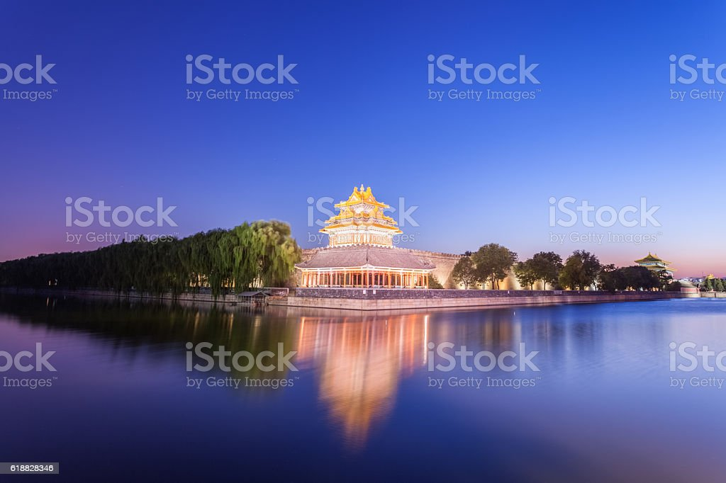 the forbidden city watchtower at night stock photo