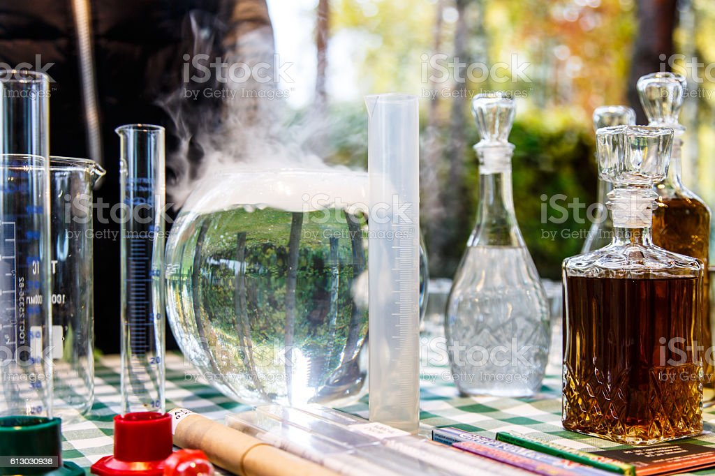 The forest alchemists. Some flasks and test tubes stock photo