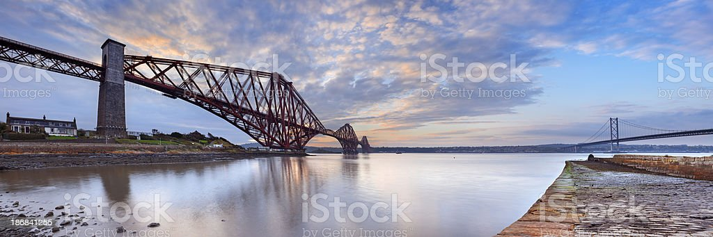 The Forth Rail Bridge near Edinburgh, Scotland at sunrise stock photo
