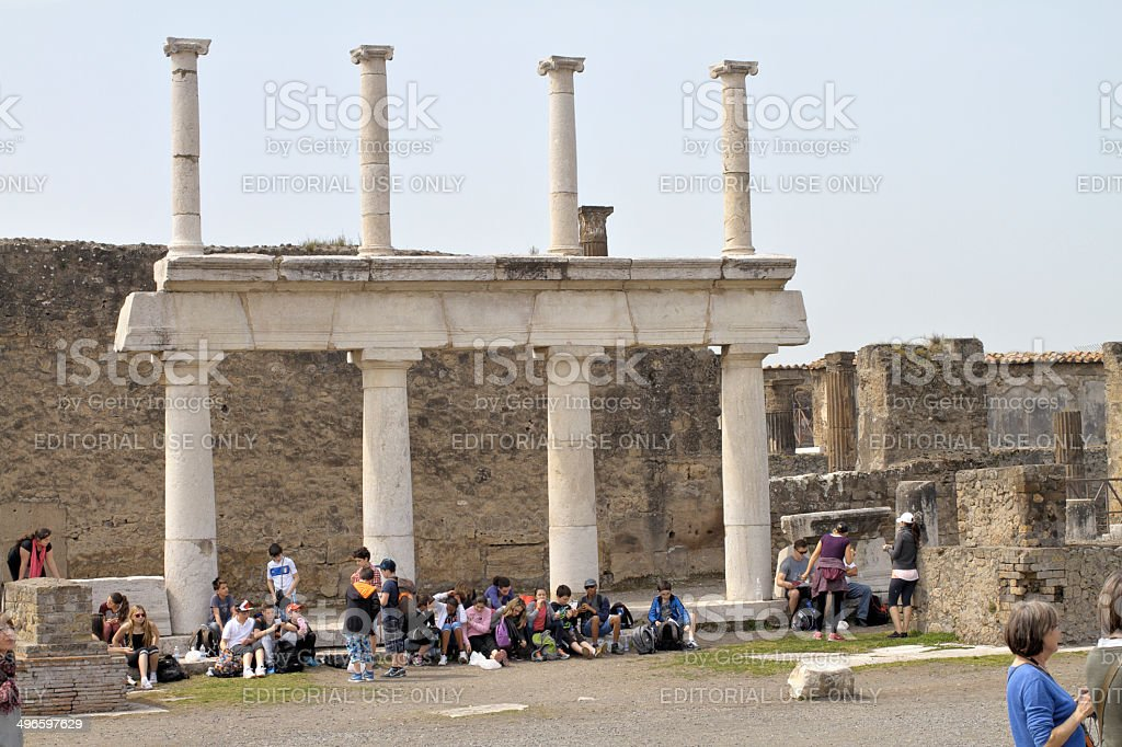 Tourists at Pompeii people's forum with Ionic columns royalty-free stock photo