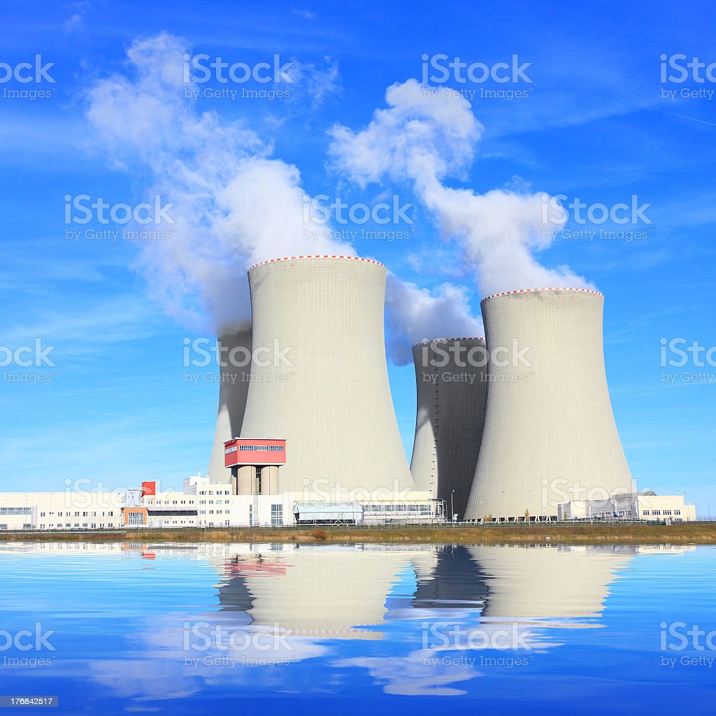 The four cooling towers of a nuclear power plant stock photo
