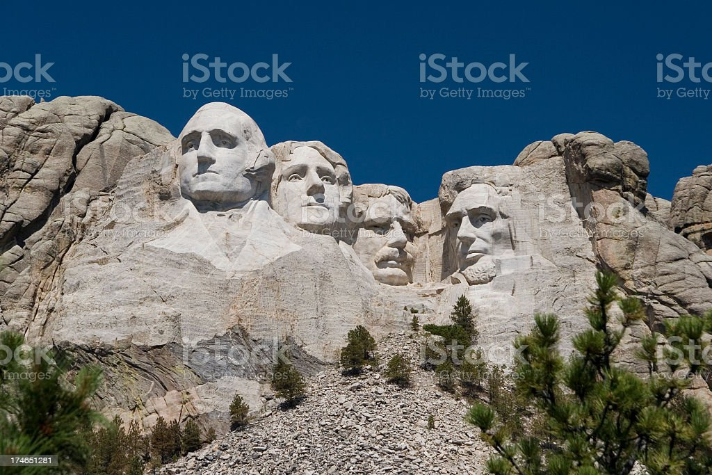 The four presidents in Mount Rushmore as seen from below royalty-free stock photo