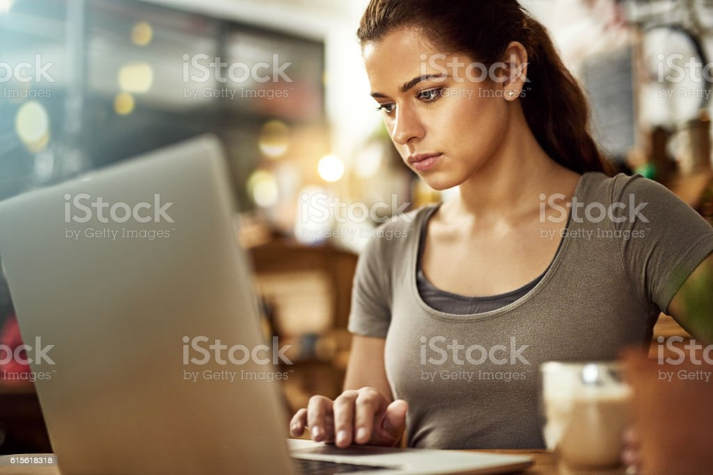 The free wifi lets her spend more time online stock photo