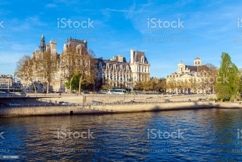 PARIS, FRANCE - APRIL 6, 2011: the French walk in front of Hotel de Ville stock photo