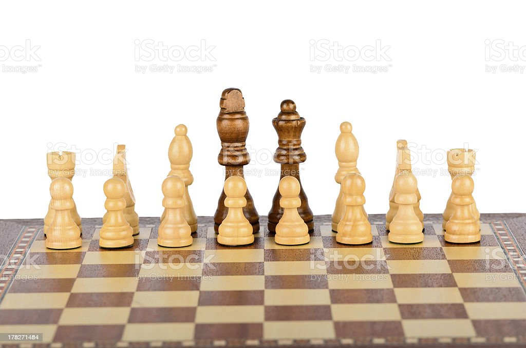 The friendship between black and white chess pieces royalty-free stock photo