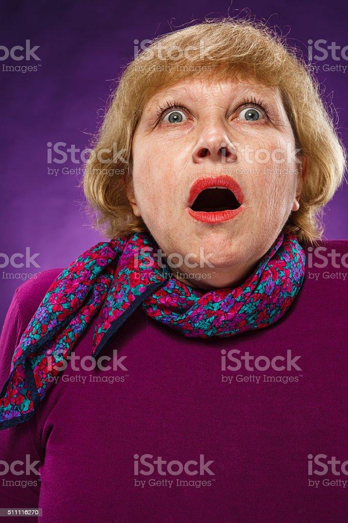 The frightened senior woman stock photo