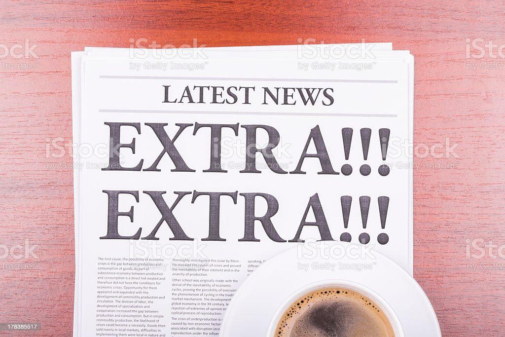 The front of a generic newspaper underneath a cup of coffee stock photo