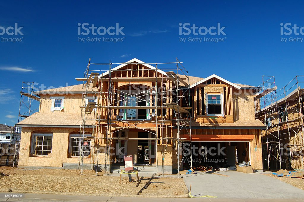 The front of a house that is under construction stock photo