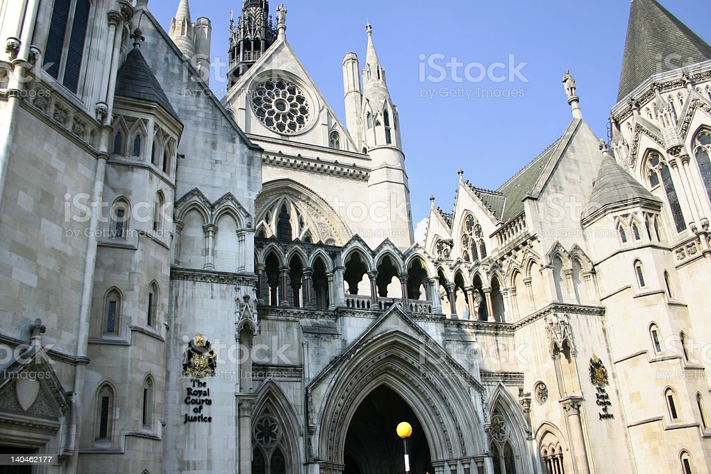 The front view of royal courts of justice stock photo