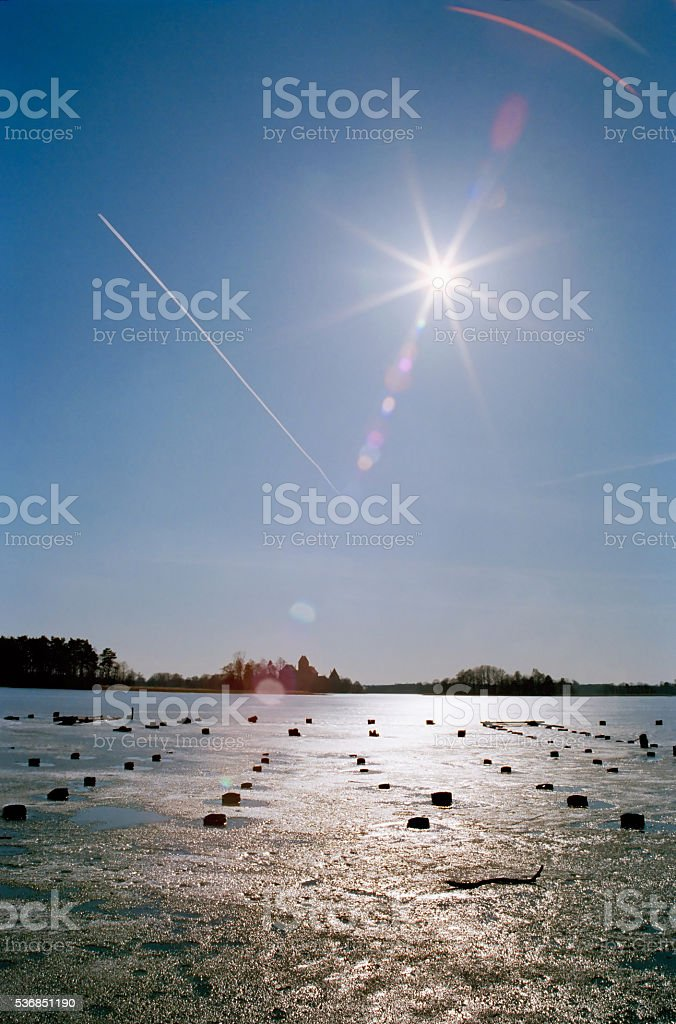 The frozen lake on a sunny day stock photo