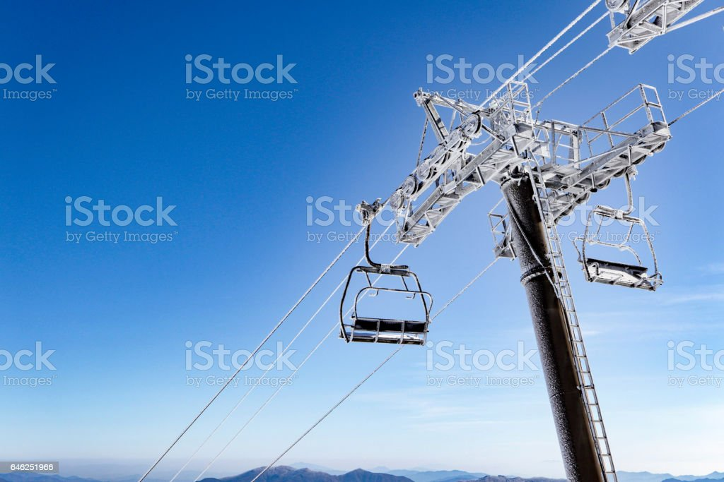 the frozen ski lift in the resort. frozen and nobody use ski lift feels lonely and solitary. stock photo
