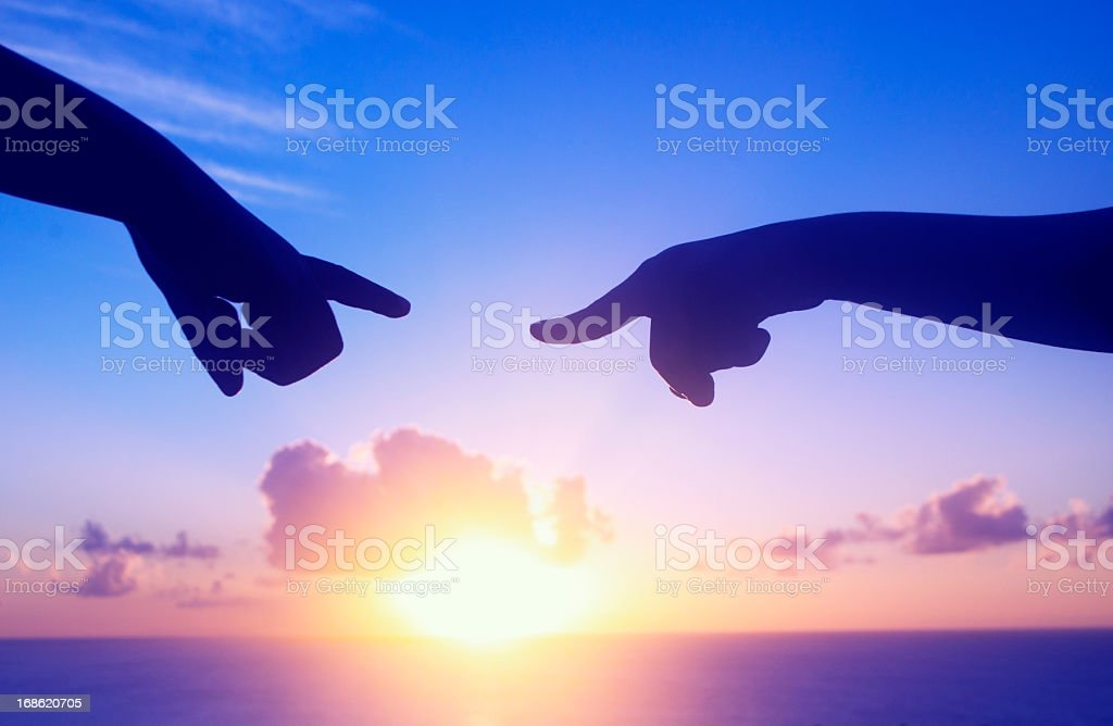 the future outlook; two hand pointing at sunset royalty-free stock photo