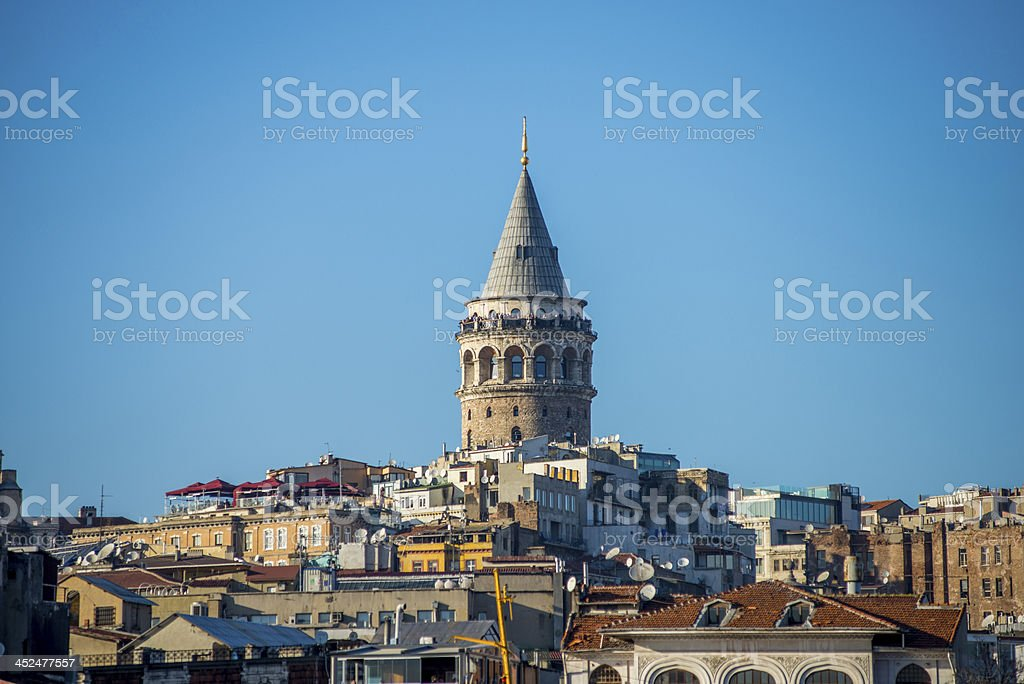 The Galata Tower against a clear, blue sky stock photo