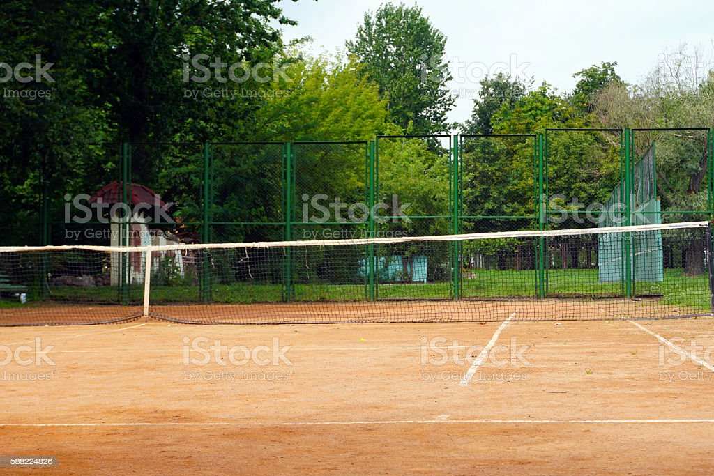 The game on the tennis court in the evening stock photo