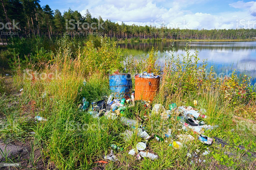 The garbage dump on the shores of clear lake . stock photo